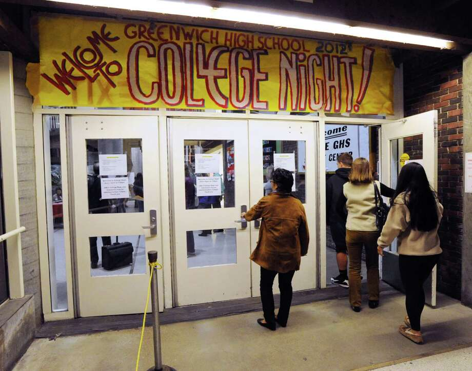A banner for college night hangs outside the Student Center at Greenwich High School, Thursday, Oct. 11, 2012. Photo: Bob Luckey / Greenwich Time