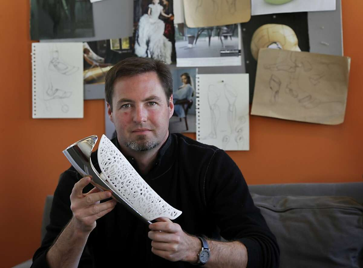 Bespoke founder Scott Summit holds one of his innovative fairings Thursday May 19, 2011. Bespoke Innovations is a San Francisco, Calif. company that features custom-tailored prosthetic leg covers or fairings.