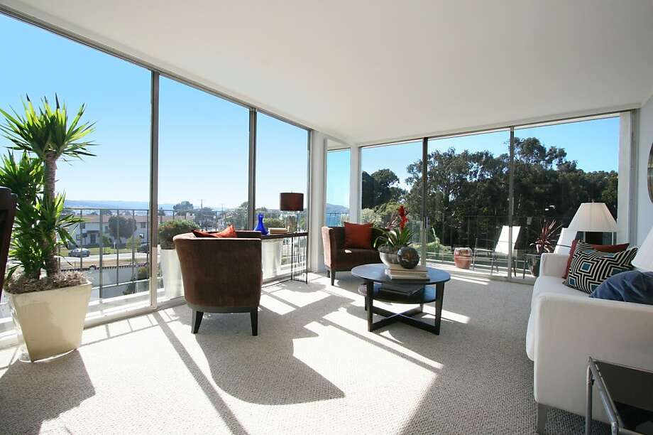 With walls of windows, the living room enjoys natural light while offering panoramic views of the city. Photo: Clay Seibert