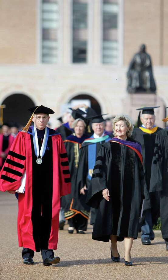 Rice University President David Leebron and U.S. Sen. Kay Bailey Hutchinson lead the Academic Procession through the quadrangle Friday. ( Mayra Beltran / Houston Chronicle ) Photo: Mayra Beltran / © 2012 Houston Chronicle
