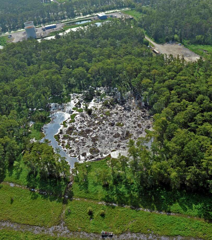 Diesel sheen is seen on the water in an aerial view of the sinkhole, left, at at Bayou Corne near Pierre Part, La., Tuesday, Aug. 7, 2012. Photo: Bill Feig, Associated Press / The Baton Rouge Advocate