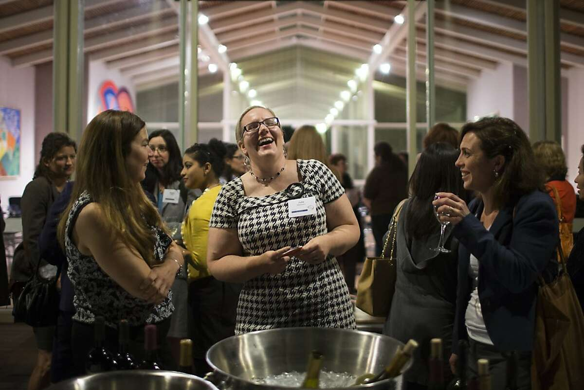 (L-R) Kathi Lutton, Julie Stephenson, and Megan Bishop Moore share a laugh during the launch party for The Club, a new Silicon Valley women's social club at Quadrus Conference Center in Menlo Park, Calif. on Thursday, Oct. 4, 2012.
