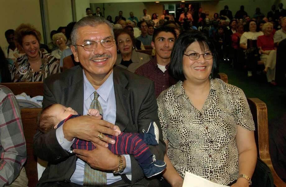 Houston State Senator Mario Gallegos holding his 7-week-old grandson, Jake Anthony Gallegos, with wife, Theresa Gallegos, listen as state Senator Rodney Ellis speaks at welcome home ceremony at  Wheeler Baptist Church, 3826 Wheeler, Thursday, Sept. 11, 2003. The senators are two of the Democrats who spent a month in Albuquerque trying to block congressional redistricting. Photo: Melissa Phillip, Houston Chronicle / Houston Chronicle