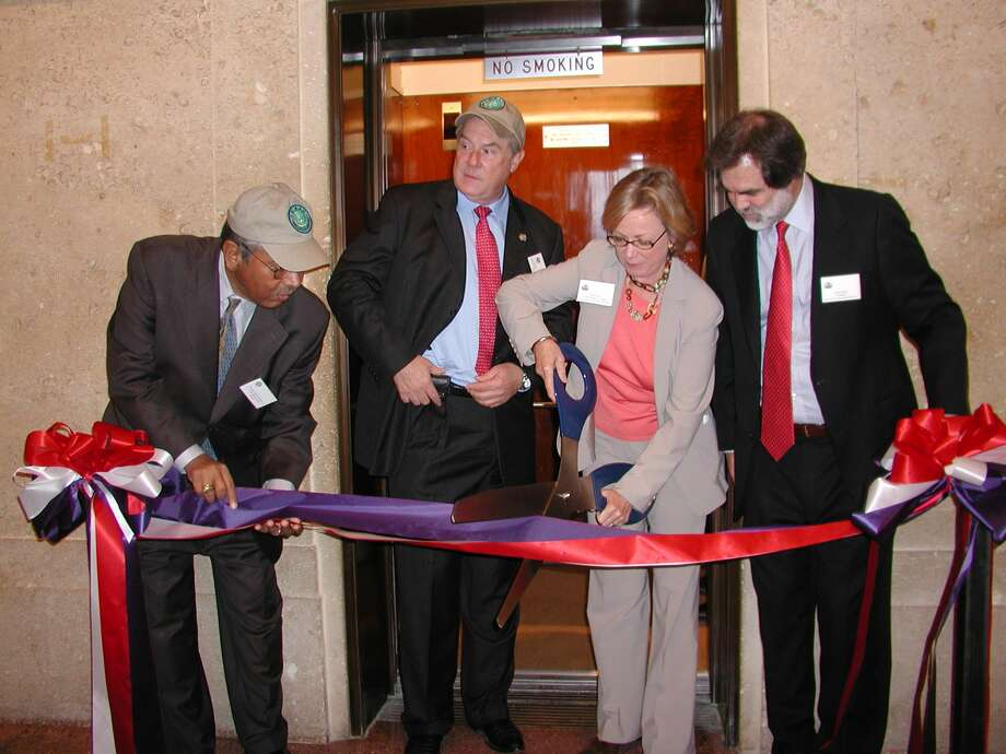 Local dignataries were on hand for the reopening of the San Jacinto Monument elevator, one of several renovations to the historical museum. Doing the ribbon-cutting honors are state Sen. Mario Gallegos, state Rep. Wayne Smith, museum Chairwoman Sarita Hixon and museum President  Larry Spasic, 2006. Photo: Fannie Williams, For The Chronicle / Freelance