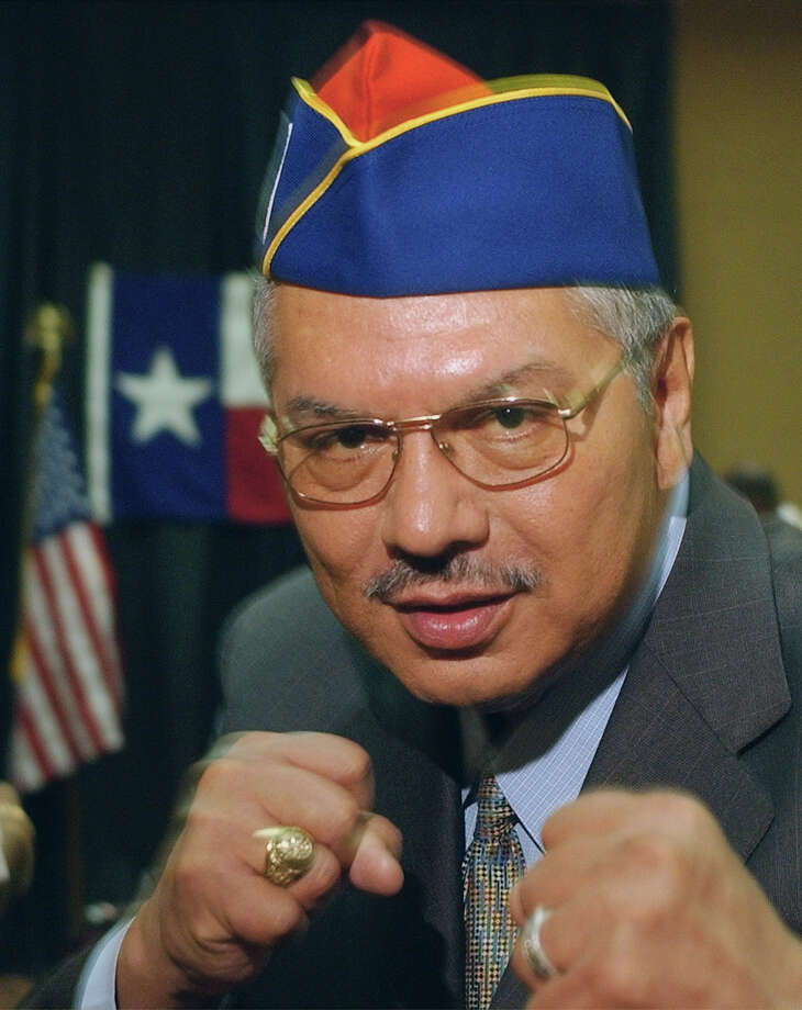 Sen. Mario Gallegos Jr., D-Houston, makes his moves toward a crowded doorway after a news conference Tuesday, Aug. 5, 2003, in Albuquerque, N.M. Gallegos and the other senators were on their way to meet with members of the American GI Forum. Gallegos is one of the 11 Texas Senate Democrats opposed to congressional redistricting who remain in New Mexico to break a quorum in Austin, Texas. Photo: HARRY CABLUCK, AP / AP