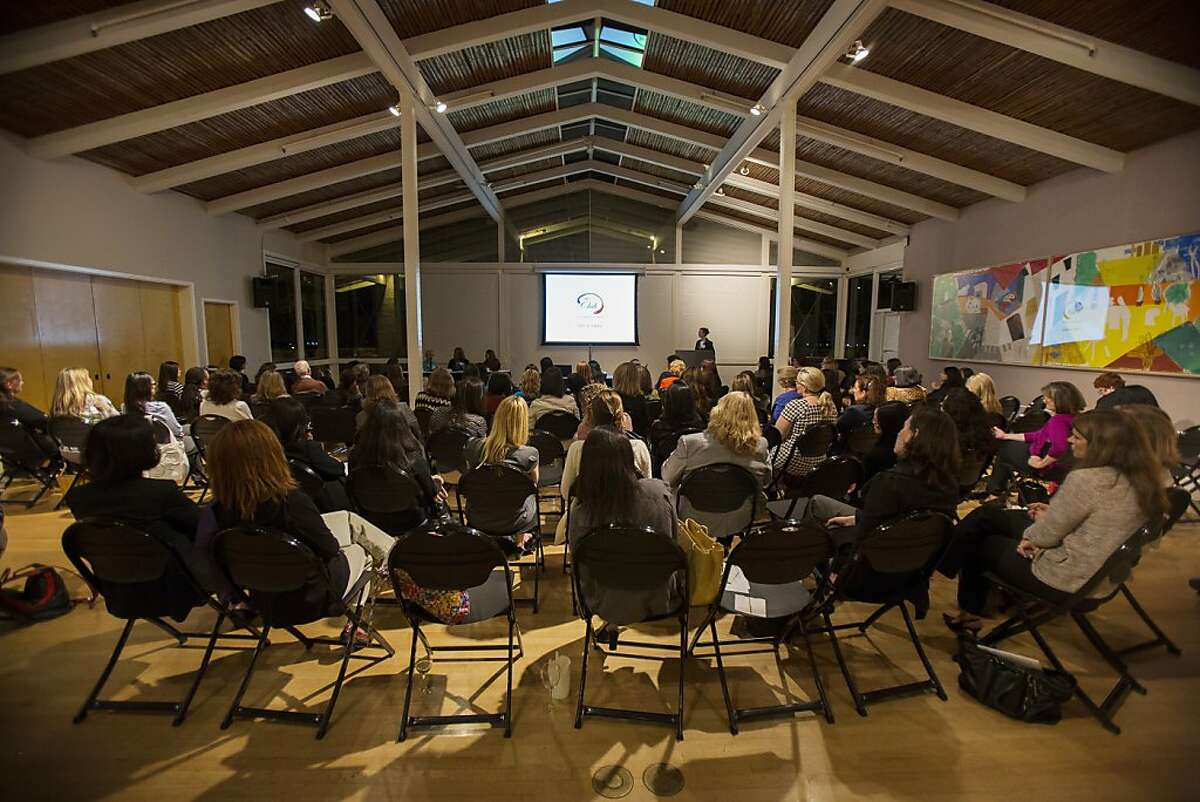 Attendees listens to a panel discussion during the launch party for The Club, a new Silicon Valley women's social club at Quadrus Conference Center in Menlo Park, Calif. on Thursday, Oct. 4, 2012.