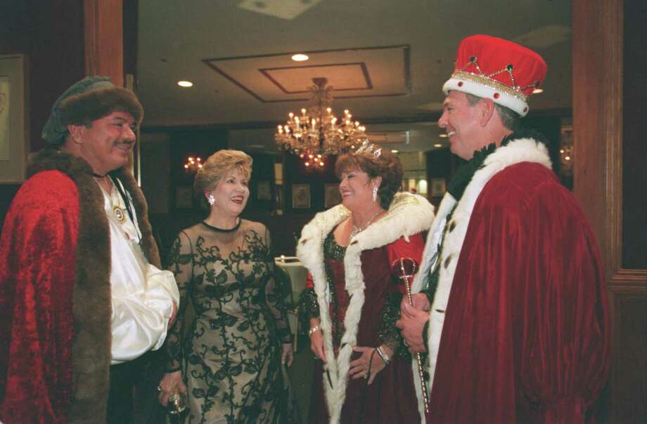 "Leading the Institute of Hispanic Culture through its 35th annual ""Noche de las Americas"" gala at the Hyatt Regency Hotel on Saturday night are, from left, state Sen. Mario Gallegos as Christopher Columbus, gala chair Miriam Sera, and Paula and Steve Letbetter as Queen Isabella and King Ferdinand, 2000. Photo: James Nielsen, Special To The Chronicle / Freelance"
