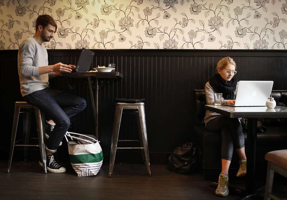 Dylan Taylor, left, and Marla Menninger work on their laptops at Cafe Jane on Friday, Oct. 12, 2012 in San Francisco, Calif. Photo: Russell Yip, The Chronicle