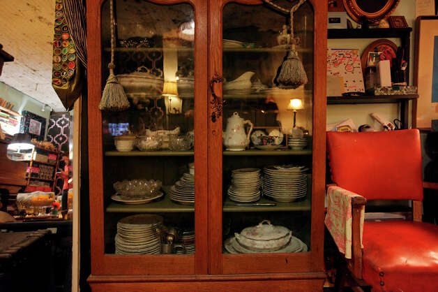 A hutch is filled with fine china collected by the couple. Photo: Edward A. Ornelas, San Antonio Express-News / © 2012 San Antonio Express-News