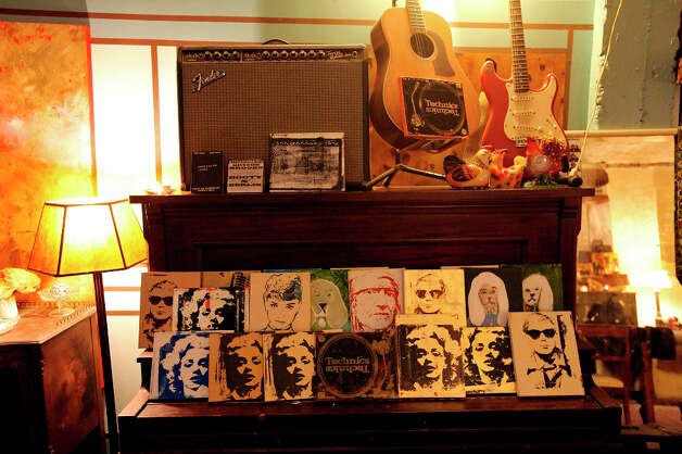Art of pop culture and musicians along with guitars. Photo: Edward A. Ornelas, San Antonio Express-News / © 2012 San Antonio Express-News