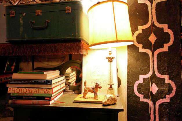 More books in the art filled home. Photo: Edward A. Ornelas, San Antonio Express-News / © 2012 San Antonio Express-News