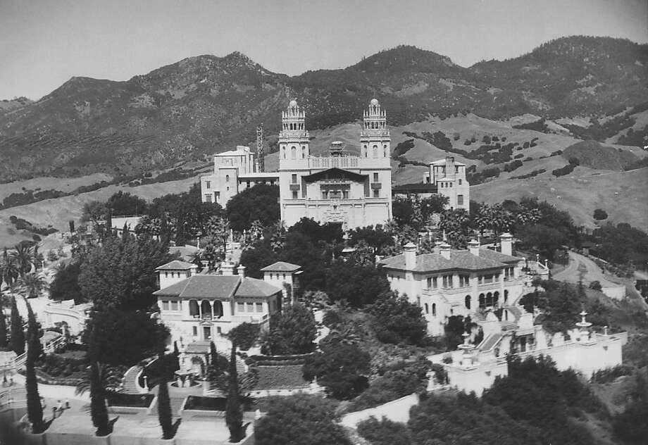 "William Randolph Hearst (left) built the Hearst Castle (above) at San Simeon, a hillside palace that seemed a ""mythical village."" It had dozens of bedrooms and was surrounded by thousands of acres of rugged land."