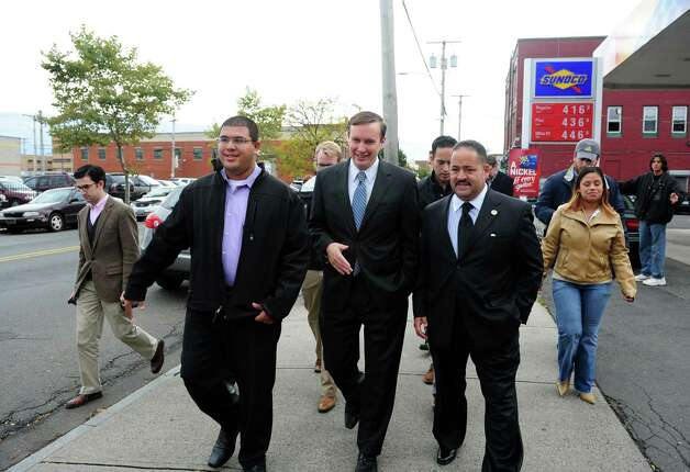 U.S. Senate candidate Chris Murphy walks down East Main Street in Bridgeport Friday, Oct. 12, 2012 with Christopher Rosario, from the Bridgeport mayor's office, left, and State Rep. Andres Ayala, candidate for State Senate, during a tour of local businesses. Photo: Autumn Driscoll / Connecticut Post