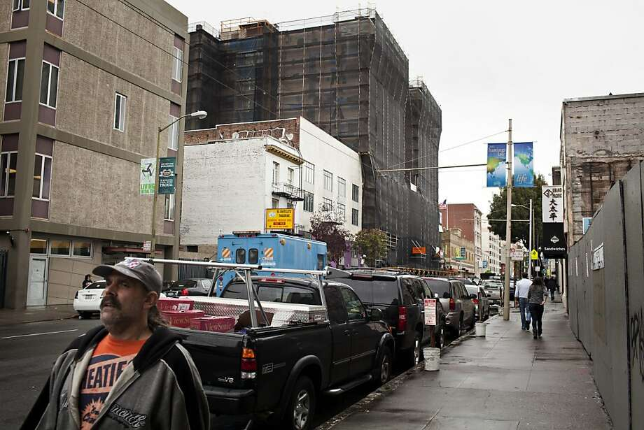 The proposed Housing Trust Fund would be a long-term source of funding for new affordable housing developments, like this former YMCA in the Tenderloin. Photo: Jason Henry, Special To The Chronicle