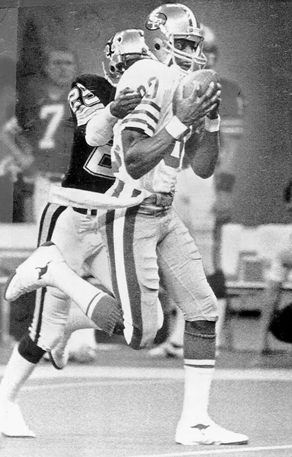 Fresh off a stellar   four-year career at Mississippi Valley State, Rice grabs a long pass from Joe   Montana on December 15, 1985. Rice was drafted 16th overall by the   49ers earlier that season, one that saw him finish with 927 yards (a   Niners rookie record) and win NFC Rookie of the Year. Photo: Frederic Larson, The Chronicle,  File