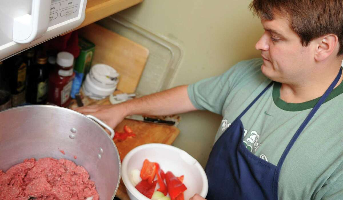 Brian Cronin prepares his 24-hour chili with top-secret ingredients in his Stamford home on Friday, October 12, 2012, for Saturday's charity chili cook-off.