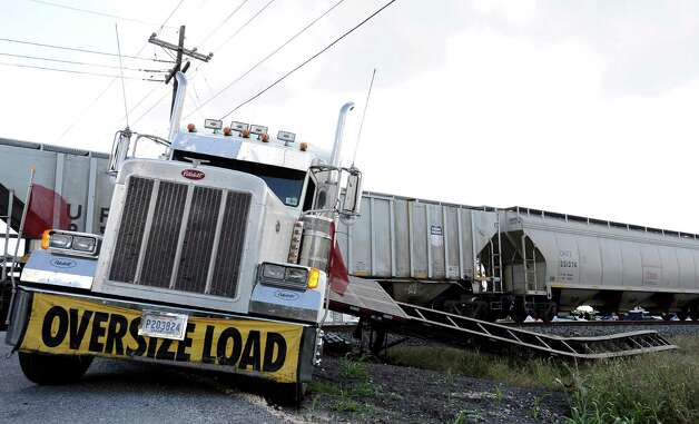 An 18-wheeler was struck by a train after it stalled on the tracks, no injuries occured.  The incident happened on US 90 near the intersection of Meeker Road - between Beaumont and China on Friday, October 12, 2012. Photo taken: Randy Edwards/The Enterprise