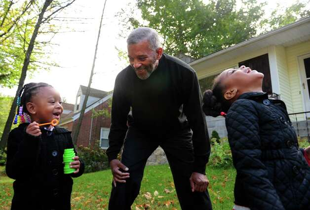 Glover Gardner plays outside with his granddaughters, Kami Gardner, 3, left, and Poet Gardner, 4, after school Friday, Oct. 12, 2012 at his home in Bridgeport, Conn. Photo: Autumn Driscoll / Connecticut Post