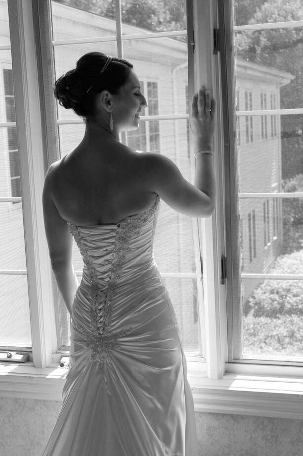 Jaime Clark of Amsterdam looks out a window of Copperfield Inn in North Creek moments before leaving to get married to Phillip Taylor in North Creek in August. Elaine Bailey, whose daughter is Clark?s good friend, took the photo just before the wedding party left for the ceremony at Ordway Pond. (Elaine Bailey)