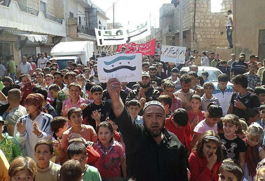 Marchers in Sarmada, northern Syria, protest the government in this citizen journalism image. Photo: Anonymous, Associated Press