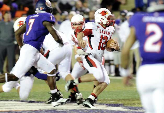 Lamar quarterback Caleb Berry, 12, rushes for 26 yards on a drive in the second quarter during Northwestern State football game against Lamar University at Northwestern State University on Saturday, October 6, 2012. Photo taken: Randy Edwards/The Enterprise
