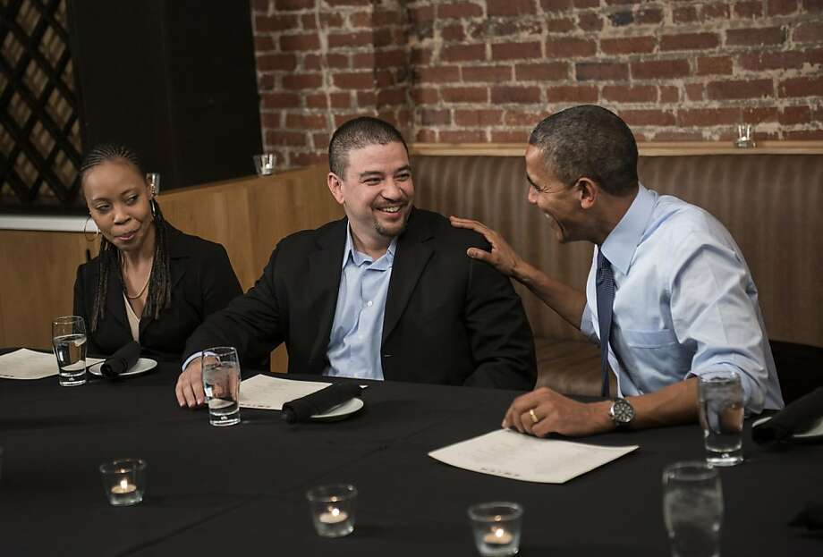 President Obama visits with donors Mario and Deidra Orosa in Washington, D.C. Photo: Brendan Smialowski, AFP/Getty Images