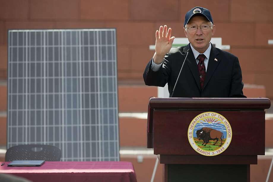 "Interior Secretary Ken Salazar speaks during a news conference, Friday, Oct. 12, 2012, in Las Vegas, in which he and Senate Majority Leader Harry Reid announced a plan that sets aside 285,000 acres of public land for the development of large-scale solar power plants. The government is establishing 17 new ""solar energy zones"" on 285,000 acres in six states: California, Nevada, Arizona, Utah, Colorado and New Mexico. Most of the land,153,627 acres, is in Southern California. Photo: Julie Jacobson, Associated Press"