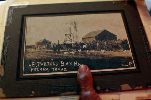 Catherine Porter holds a historic photo of her husband's family farm in Pelham, at their home in Pelham on August 12, 2012. Photo: Lisa Krantz, San Antonio Express-News / © 2012 San Antonio Express-News