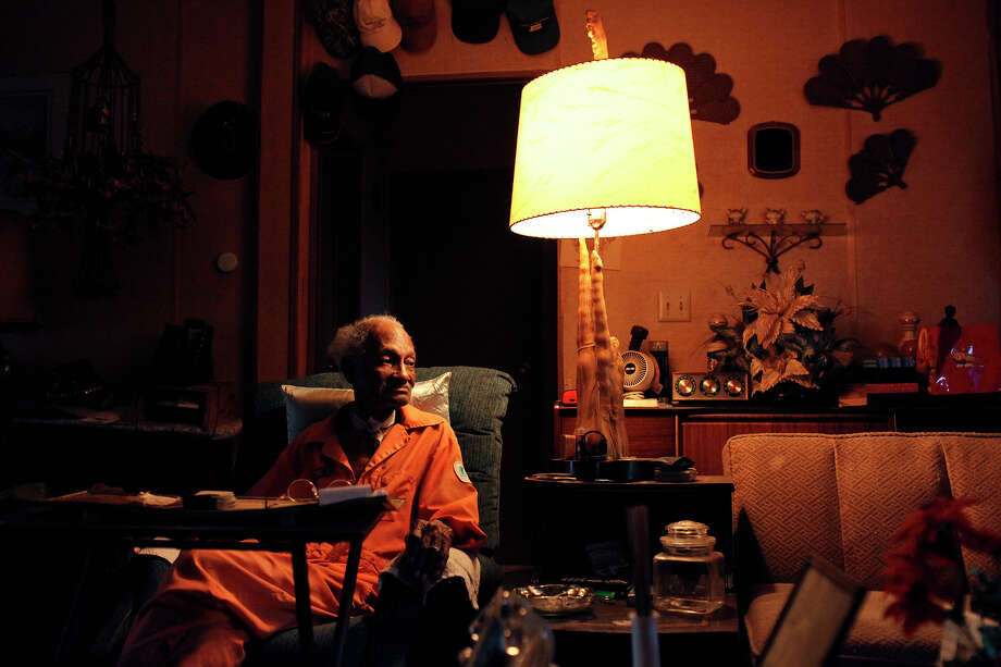 Pelham native Elvis Caruthers, 90, watches television at his home in Pelham. Caruthers, who lost his wife ten years ago, says his life is boring and lonely with out her. He had a career as a dining car waiter on cross-country trains and lived in California so his children could attend integrated schools, before returning to Pelham, now living on the land he was born on. Photo: Lisa Krantz, San Antonio Express-News / © 2012 San Antonio Express-News