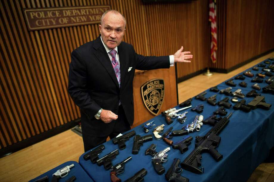 Police Commissioner Ray Kelly speaks to the media over a table of confiscated firearms during a press conference concerning gun trafficking, Friday, Oct. 12, 2012 in New York. Kelly, Mayor Michael Bloomberg, and Manhattan District Attorney Cyrus R. Vance Jr. announced that 16 members of two East Harlem gun trafficking networks are charged with selling more than 100 illegal firearms, including assault weapons and machine guns.  (AP Photo/John Minchillo) Photo: John Minchillo