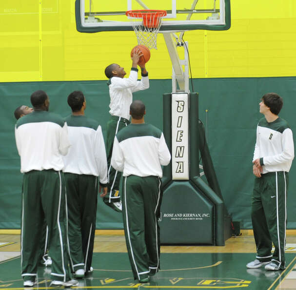 Siena basketball player Evan Hymes takes a shot during media day for the Siena basketball team Frida