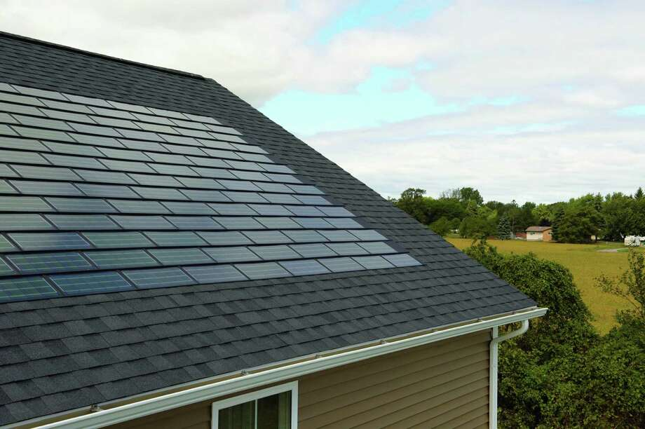 Purchase rooftop solar shingles to help offset your energy use. Photo: Courtesy Photo / Photos courtesy Dow Chemical Co.