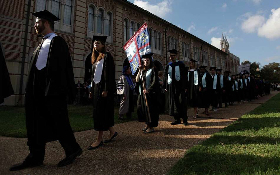 Students participate in Rice University's Academic Procession as part of their centennial celebratio