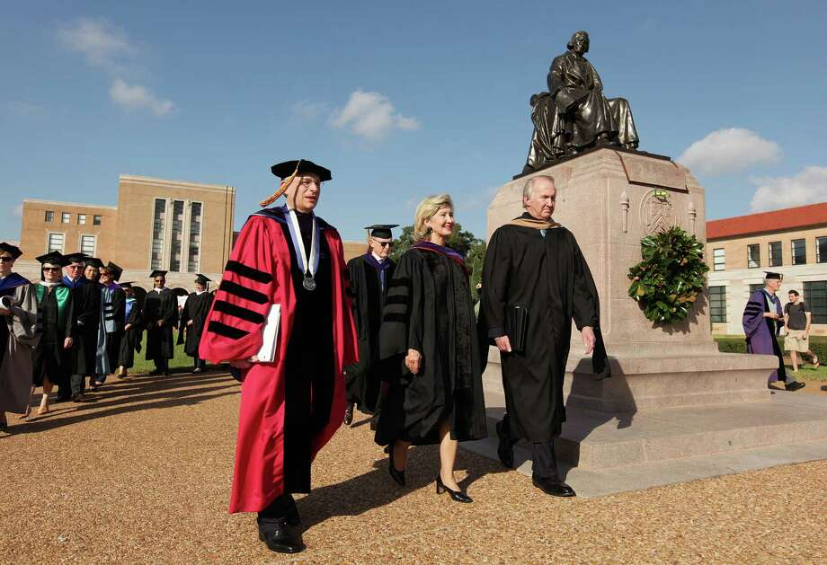 Rice University President David Leebron, U.S. Sen. Kay Bailey Hutchinson, and James W. Crownover, Chairman, Board of Trustees,   lead the Academic Procession after they laying of the wreath on the tomb of founder WIlliam Marsh Rice at the Academic Quadrangle on Friday, Oct. 12, 2012, in Houston. Photo: Mayra Beltran, Houston Chronicle / © 2012 Houston Chronicle
