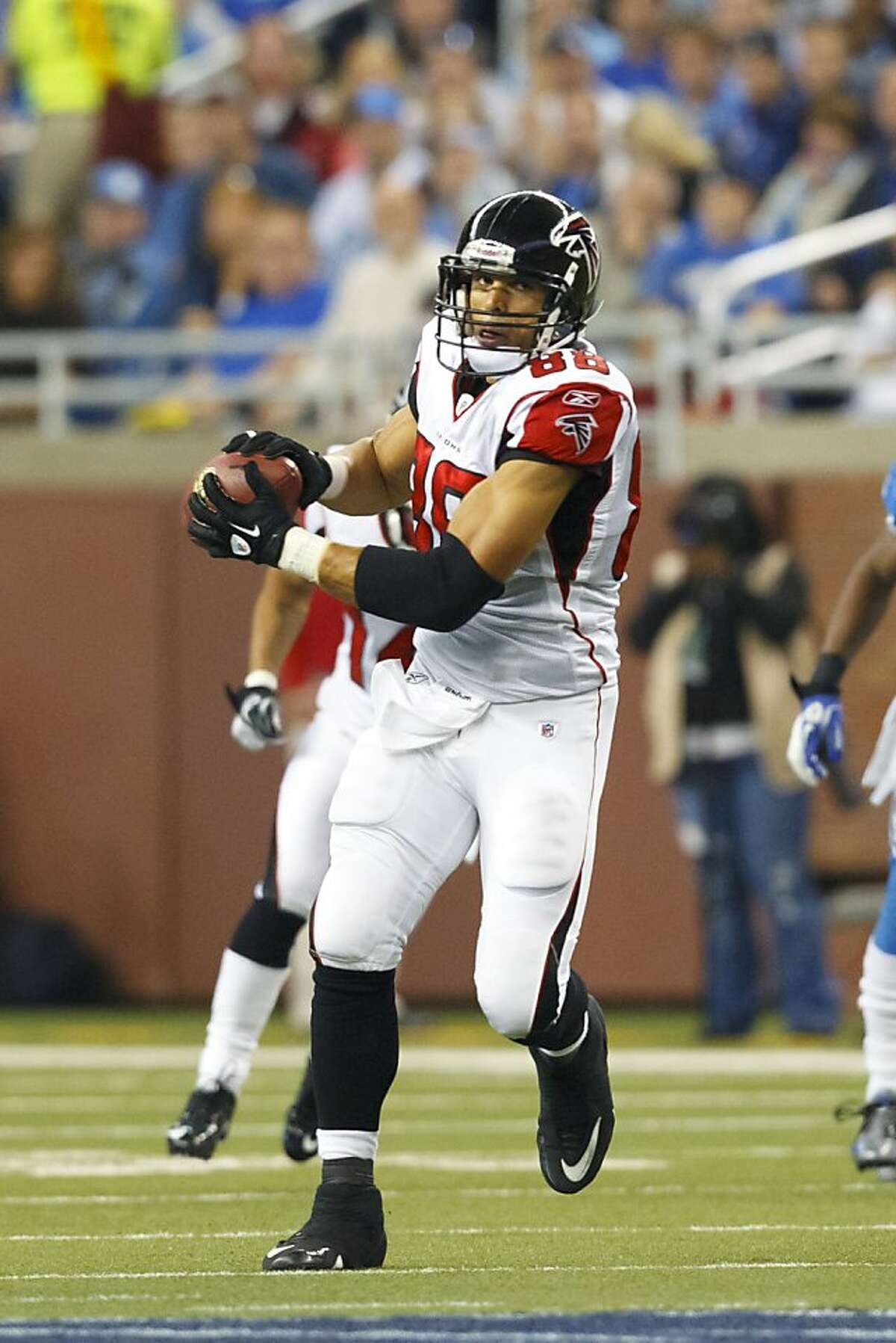 Atlanta Falcons tight end Tony Gonzalez (88) pulls in a reception during the second quarter of an NFL football game against the Detroit Lions in Detroit, Sunday, Oct. 23, 2011.