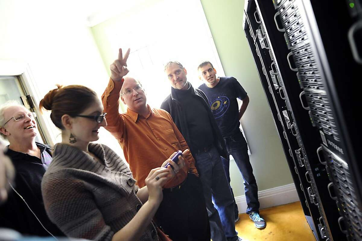 Founder Brewster Kahle(3rd from left) talks about the servers as he gives a tour to visitors at the Internet Archive offices in San Francisco Friday September 28th, 2012.