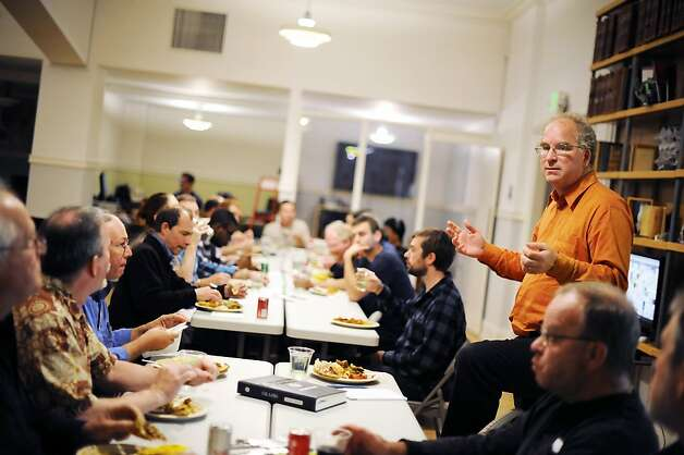 Founder Brewster Kahle(standing) talks to employees and visitors during a regular Friday lunch/meeting at the Internet Archive offices in San Francisco Friday September 28th, 2012. Photo: Michael Short, Special To The Chronicle