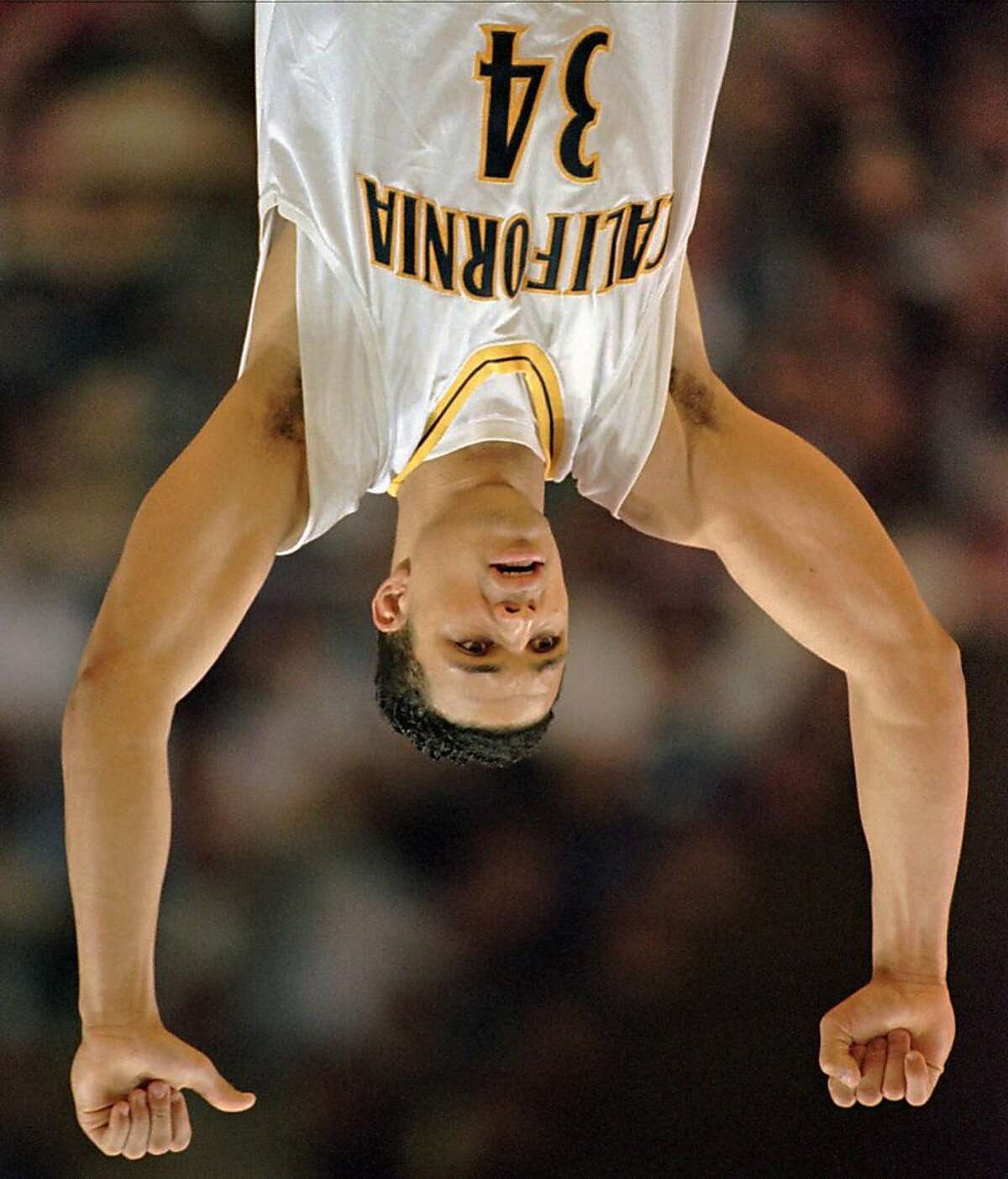 California forward Tony Gonzalez raises his arms in victory after the Golden Bears defeated the Princeton Tigers 55-52 in the first round of the NCAA East Regional tournament on Thursday, March 13, 1997, in Winston-Salem, N.C. Gonzalez scored all five of Califonia's points in the last minute to secure the victory. (AP Photo/John Bazemore)