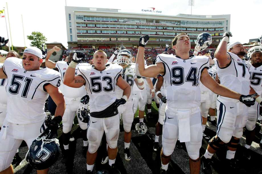 Members of the Connecticut football team acknowledge fans in the stands after an NCAA college football game against Maryland in College Park, Md., Saturday, Sept. 15, 2012. Connecticut won 24-21. (AP Photo/Patrick Semansky) Photo: Patrick Semansky, Associated Press / Associated Press