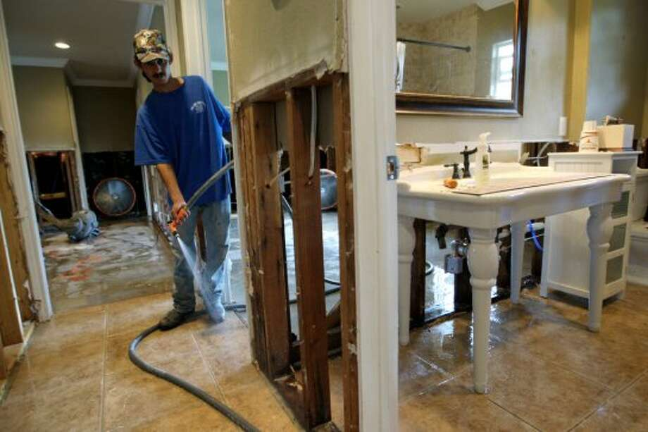 Texas has the highest percentage of basic named-perils policies in the country. Without flood insurance, a cleanup job like this could come out of your pocket. (San Antonio Express-News)