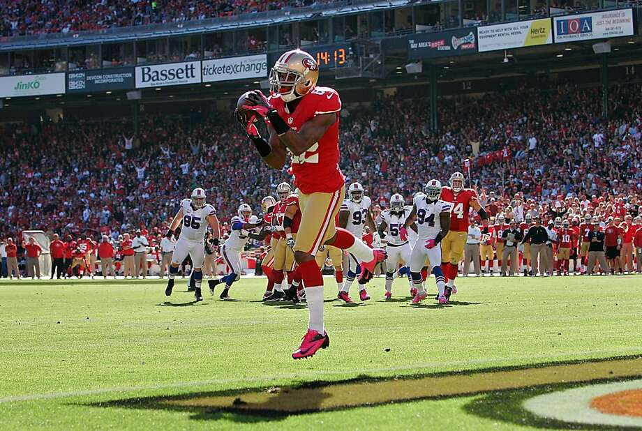Mario Manningham is alone with his thoughts - and the football - in scoring his first touchdown as a 49er. Photo: Brian Bahr, Getty Images