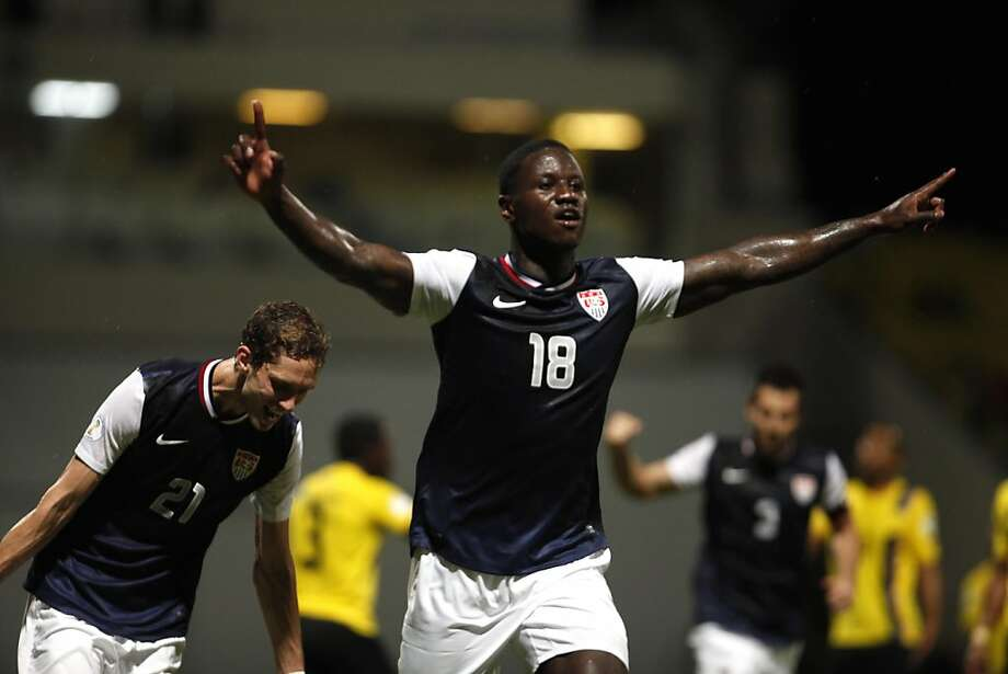 Eddie Johnson celebrates the first of his two goals for the U.S. Photo: Ricardo Arduengo, Associated Press