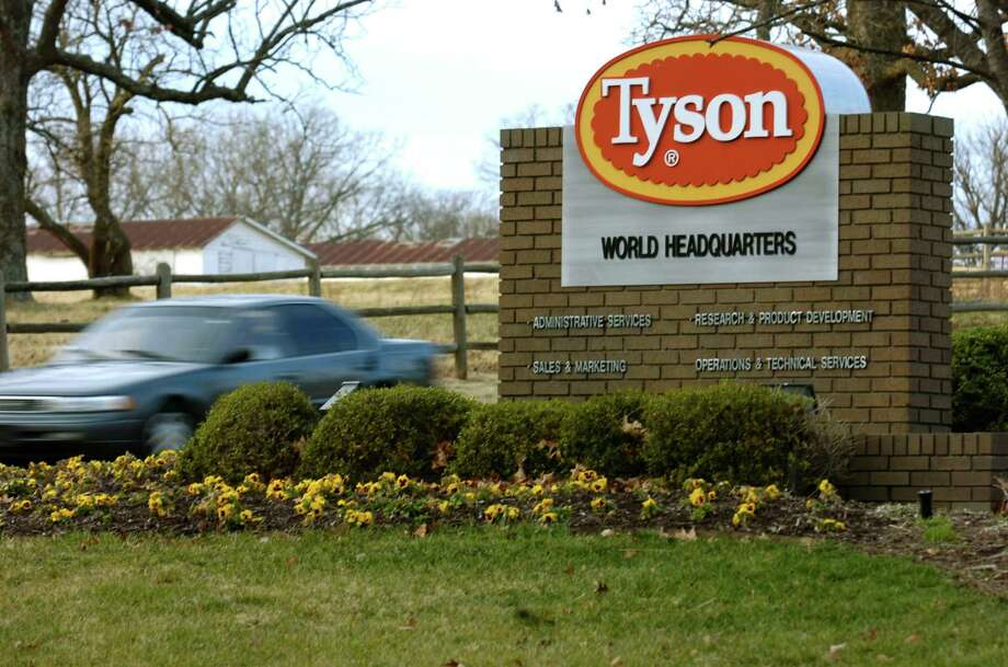 FILE - In this Jan. 29, 2006, file photo, a car passes in front of a Tyson Foods Inc., sign at Tyson headquarters in Springdale, Ark.  The nation's largest meat company on Friday, Oct. 12, 2012, says it's launching an animal treatment audit of suppliers' farms. The news comes as animal welfare activists have been pressuring Tyson to move away from cramped cages for pregnant pigs. (AP Photo/April L. Brown, File) Photo: APRIL L BROWN / AP