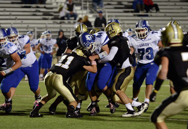 Darien's Christian Bognar (44) carries the ball as Trumbull defends during the football game at Trumbull High School on Friday, Oct. 12, 2012. Photo: Amy Mortensen / Connecticut Post Freelance