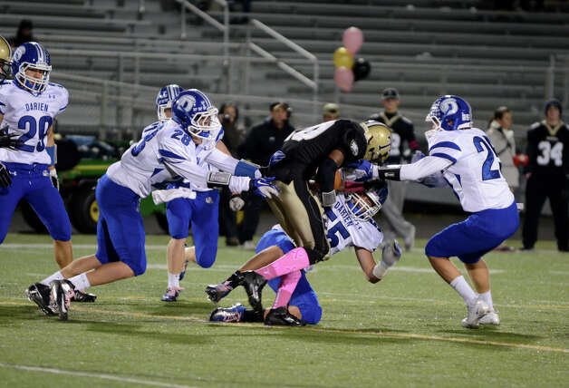 Trumbull's Mike Williams (10) is taken down by Darien during the football game at Trumbull High School on Friday, Oct. 12, 2012. Photo: Amy Mortensen / Connecticut Post Freelance