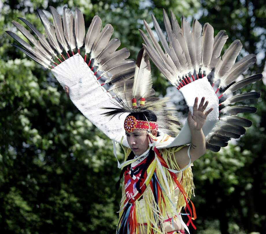 FILE - In this May 27, 2006 file photo, Joseph Bearstail. a member of the Sioux tribe from Preston, Conn., wears a costume with eagle feathers while performing a traditional dance during the American Indian Arts Festival at the Rankokus Indian Reservation in Westampton, N.J. The Justice Department on Friday, Oct. 12, 2012 said it is going to allow members of federally recognized Indian tribes to possess eagle feathers, although that's a federal crime. (AP Photo/Mel Evans, File) Photo: MEL EVANS