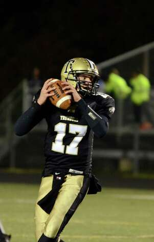 Trumbull quarterback Nick Roberts (17) looks to pass during the football game against Darien at Trumbull High School on Friday, Oct. 12, 2012. Photo: Amy Mortensen / Connecticut Post Freelance