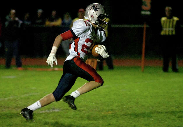New Fairfield's #22 Collin Cioffi carries the ball into the endzone for a touchdown, during boys football action against Masuk in Monroe, Conn. on Friday October 12, 2012. Photo: Christian Abraham / Connecticut Post