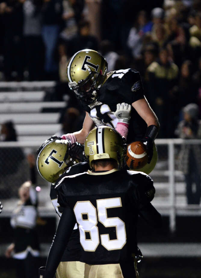Trumbull's Daniel Paolino (11) celebrates a touchdown during the football game against Darien at Trumbull High School on Friday, Oct. 12, 2012. Photo: Amy Mortensen / Connecticut Post Freelance