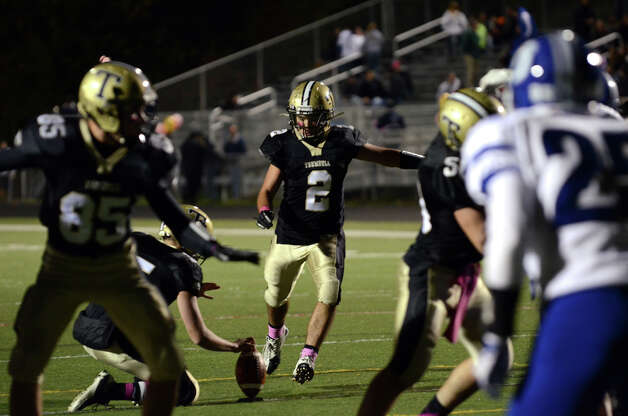 Trumbull's Ryan Pearson (2) kicks for the extra point during the football game against Darien at Trumbull High School on Friday, Oct. 12, 2012. Photo: Amy Mortensen / Connecticut Post Freelance